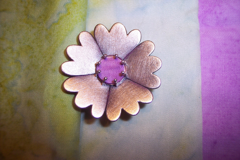 "A brooch Annie made for her mother based on her mother's quilt ""Gloria's Garden""."